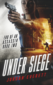 Under Siege: End of an Assassin Book Two by Jordan Everett. A woman holds a gun up overlaid against a man in the distance on a street holding a rifle up as he walks toward a building.